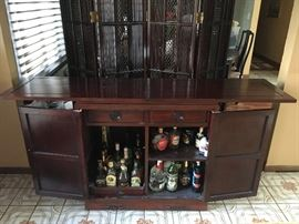 The bar that is part of the dining room set. This photo shows it fully opened and ready for entertainment.