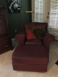 Leather club chair - Actually dark brown - has a matching sofa and loveseat.