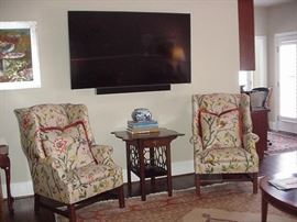 Pair of wing chairs, mahogany occasional table with fretwork sides; Vizio flat screen television
