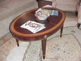 Oval banded mahogany coffee table