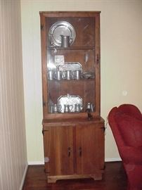 Pine display cabinet with pewter accessories
