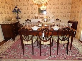 """Prince of Wales"" Shield back dining chairs (6 plus 2 armchairs), mahogany dining table with 2 leaves."