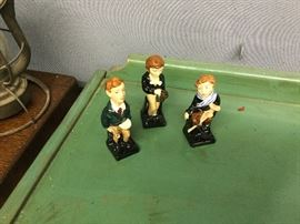 Royal Doulton figures Tiny Tim, Oliver Twist, and David Cooperfield