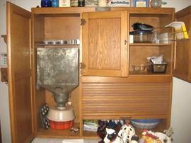 Oak Hoosier-style cabinet with internal mechanism, McDougall brand