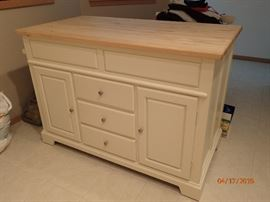 "This amazing versatile island is 56 1/2"" long x 30"" wide x 39"" tall the pull out for additional seating is 25"" deep x 47 1/2"" wide the front side has door & drawers Plus a  butcher block top also a towel bar on the end. And it come with 2 chairs."