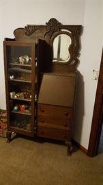 Antique carved walnut slant front secretary cabinet