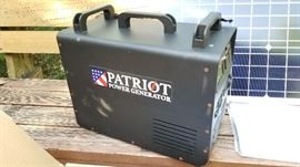 Complete new in box 1500W solar power generator. Patriot brand generator, Lion energy solar panel.