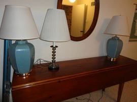 LOTS OF LAMPS ON A DROP LEAF TABLE