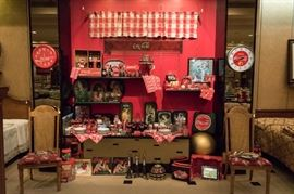 A large selection of Coke collectibles.
