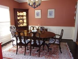 Complete 7 piece table 6chairs 4 leaves our price $1,100.00 OUR PRICE-Henkel Harris Dining room set, Henkel Harris Dining room table dual claw foot pedestal(Sold ebay $700.00) our price $500.00 and 6 chairs (1 is a Captain) $600.00- Sold ebay $1100.00-$1600.00 this year.Plus  Accent chair($75.00) seen on Left , 4 leaves and Henkel Harris China Cabinet.     (FYI- HENKEL HARRIS - SOLID CHERRY SPNEA QUEEN ANNE ARM CHAIR MODEL 104A - Sold on ebay for $385.00 chair only)  Quality area Rug  7foot x 10.5 foot long