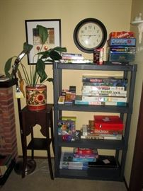 Living Room: Games-Monopoly-Sorry-Pay Day, Clock, Plant Stand, Plant,