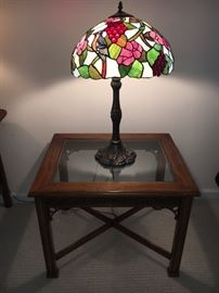 Contemporary leaded stained glass lamp and one of several small tables.