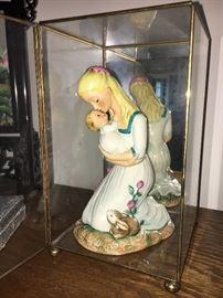 Goebel porcelain figurine in glass display case.