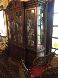 Beautiful china cabinet and antique baby carriage