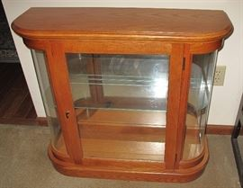 Small table top oak curved glass display cabinet.