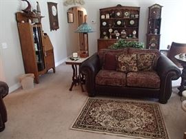 Leather/ cloth love seat, floor lamp , etc.