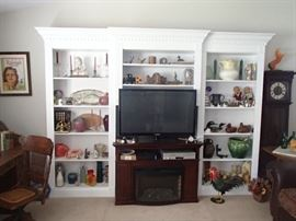 Living room stocked with collectibles