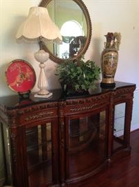 Lovely display cabinet; Italian Murano lamp; round mirror; other Asian selections