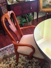 One of four chairs around the antique oak table