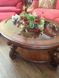 Oval glass top 2-tier coffee table