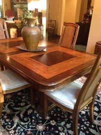 Dining table and chairs have matching server and china cabinet.