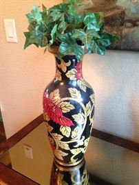 Red, gold, and black vase