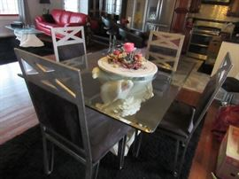 Contemporary Dining Table, Glass top and Chrome chairs