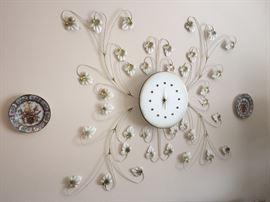 Vintage metal wall clock with leaves