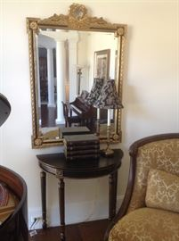 "Black half moon table measures 36w x 18 d x 32 h, - $125    LaBarge mirror measures 53 x 38, - $495 candlestick lamp measures 30"" h.     $45"
