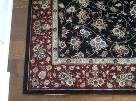 Rug in the entry measures 5 x 8...black with burgundy$100