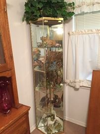 Glass & brass curio cabinet. Hand painted ceramic animals.
