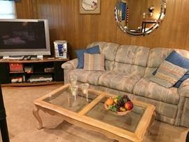La-z-Boy sofa w/recliners, glass top coffee table, flat screen TV and stand.