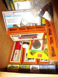 Tyco Trains, Cars and tracks. There are five or six complete train sets with entire towns