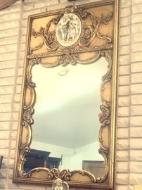 Incredible mirror with inset bisque porcelain medallion