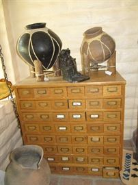 multi drawer cabinet and ollas.