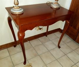 "Solid wood, cherry finish, entryway/side table with tall Queen Anne legs by Bombay Company.  30"" wide, 19"" deep, 27"" tall."