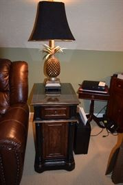 Black and Wood Tone Accent End Table with Drawer and Cabinet Storage