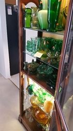 Curio cabinet, uranium glass bowl and vase, assortment of green and brown glassware.