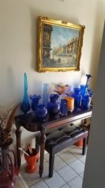 Original oil painting 20 x 24 plus framing. Bombay sofa table and assorted blue glass vintage vases and misc.