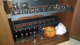 Vintage buffet with hidden bar. Various barware glasses.