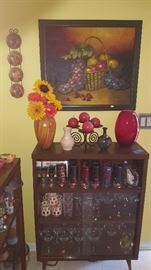 Original Kance oil painting and vintage barware. Cabinets sold.