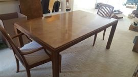 $175. Oblong table with four chairs