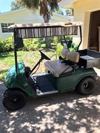 EZ - Go gas powered cart with carry box, fresh tires, lights & turn signals