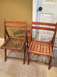 2 wooden folding chairs