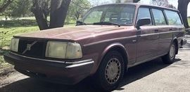 At 8PM: 1992 Volvo 240 Station Wagon | Wine Red Metallic Exterior; Antilock Brakes; Power Locks, Windows; Reclinding Front Seats with Adjustable Lumbar Support; Four-speed Automatic Transmission with Overdrive; Air Conditioning; AM/FM Stereo with Cassette; Odometer: 119,474 Miles. VIN: YV1AWB805N1934947