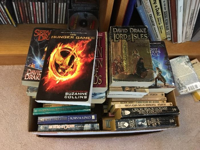 Many Sci Fi and Fantasy books, Hobbit, etc...