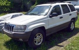 2003 Jeep Grand Cherokee 4x4 | White Exterior, Black Leather Interior; 125,710 Miles; Power Windows, Locks, Mirrors, Seats; Power Moonroof; Remote Keyless Entry; Heated Seats; AM/FM Stereo with CD and Casette, and more. VIN: 1J4GW48S73C501412.