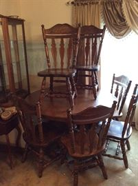 6 Matching Oak Chairs - $125