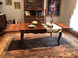 dining room table that is small enough and  pulls out on the sides for  a large table.  This can also be used as a kitchen table