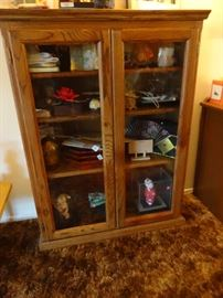 Glass door bookcase or china cabinet.